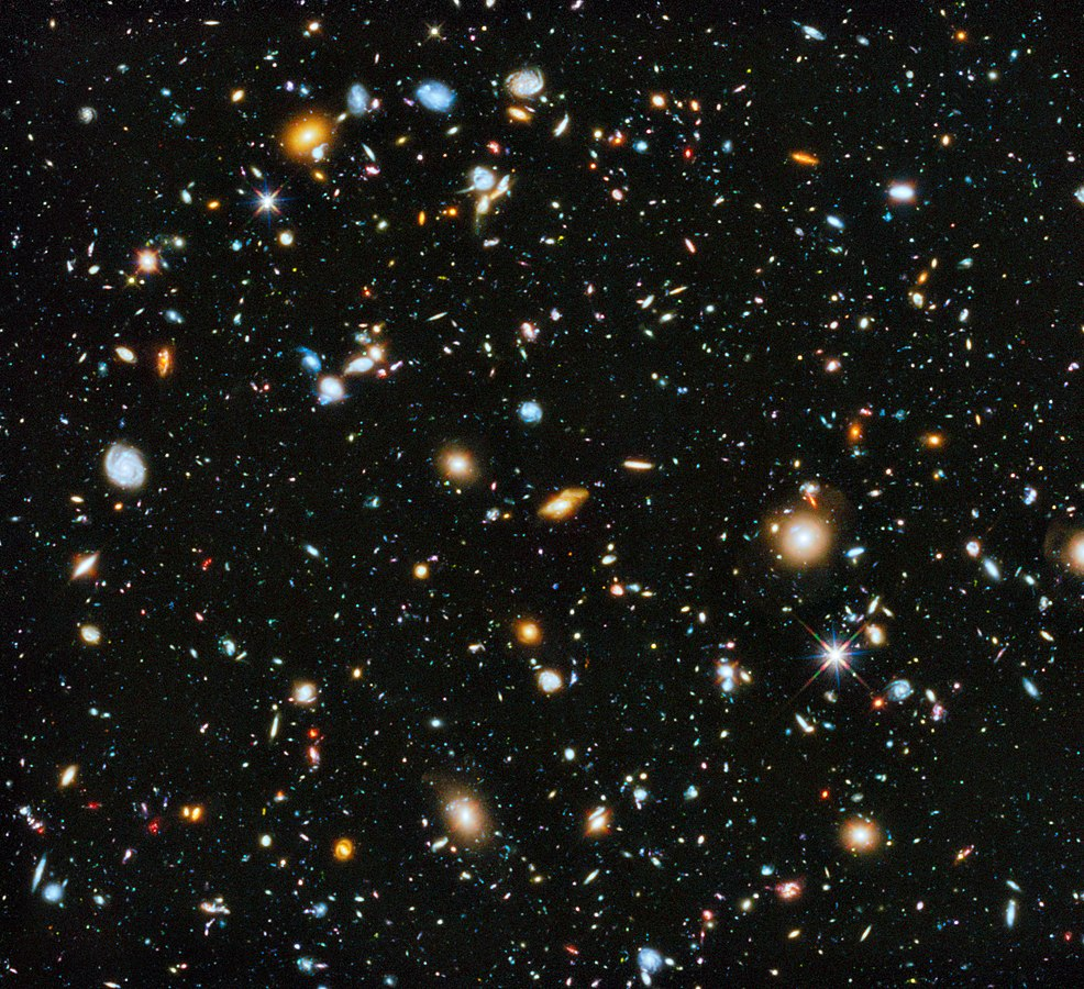 The Hubble Ultra-Deep Field image, showing many different far, far away galaxies; in most cases, it took billions of years for the light from these galaxies to reach Earth. Each galaxy shown may be composed of many billions of individual stars, each of which may have its own solar system of planets.